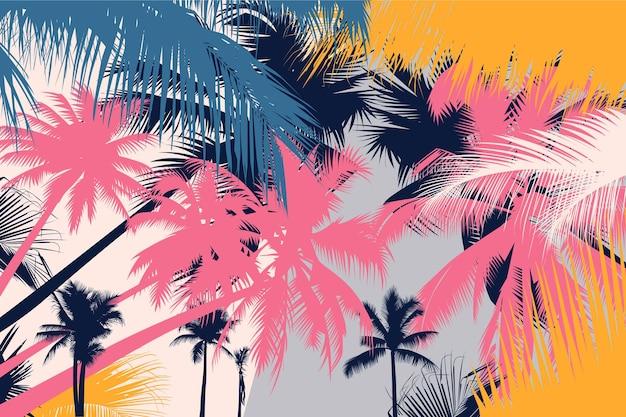 Sfondo di sagome di palme colorate Vettore gratuito