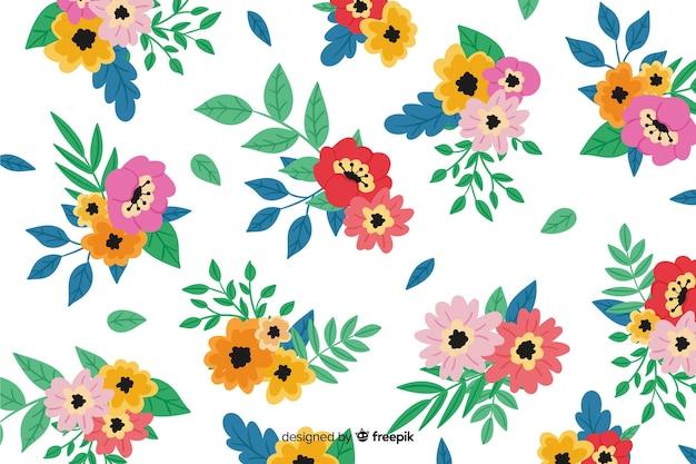 Sfondo floreale colorato dipinto a mano Vettore gratuito