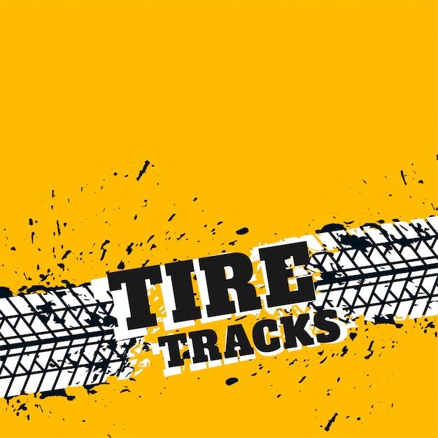 Sfondo giallo con segni di pneumatici grunge Vettore gratuito