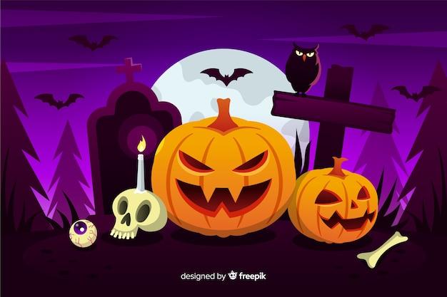 Sfondo piatto halloween con zucche Vettore Premium