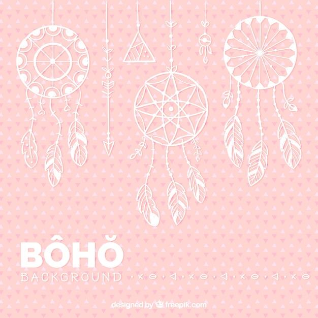 Sfondo rosa con dreamcatchers piatti appesi Vettore gratuito