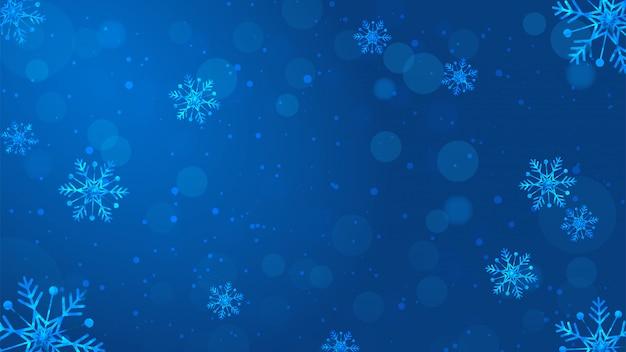 Sfondo sfocato fiocchi di neve Vettore Premium