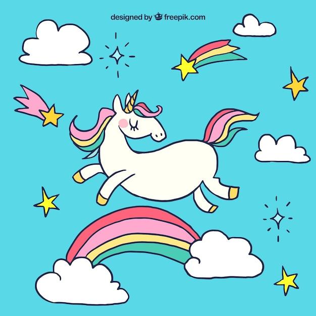 Sfondo Unicorno con arcobaleno disegnato a mano Vettore gratuito