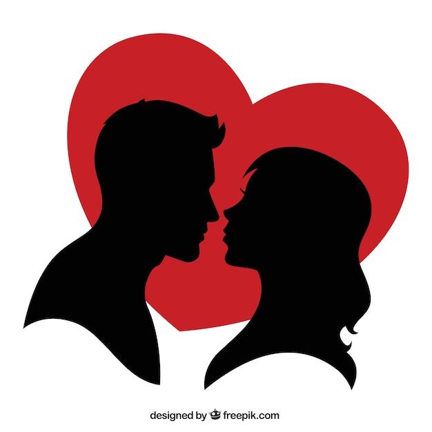 Silhouette di una coppia e un cuore rosso Vettore gratuito