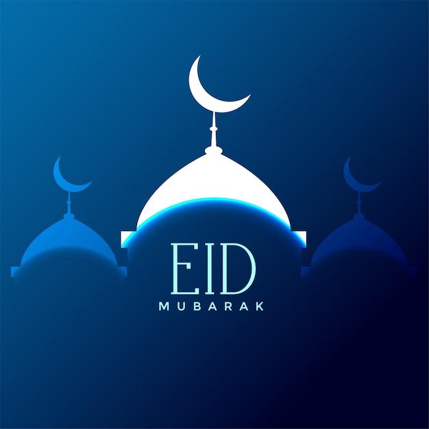 Siluetta della moschea di eid mubarak su sfondo blu Vettore gratuito