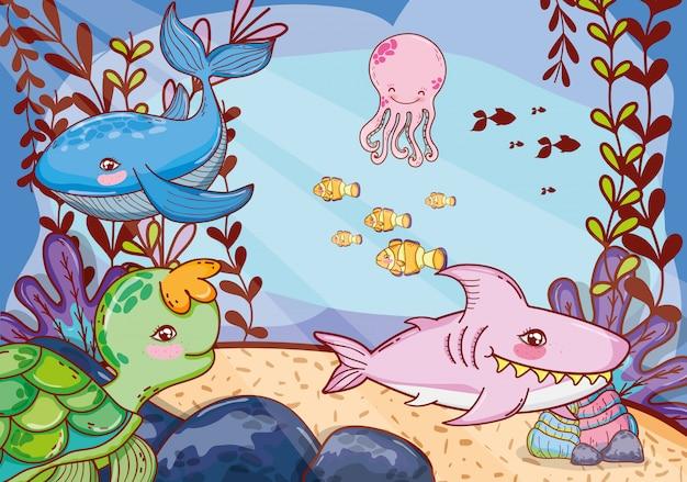 Simpatici animali marini con piante di alghe marine Vettore Premium