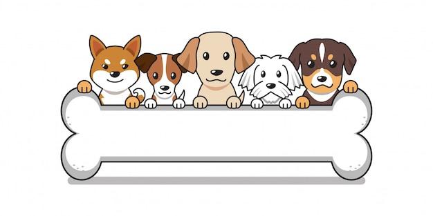 Simpatici cani dei cartoni animati con grande osso Vettore Premium