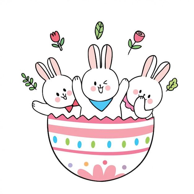 Simpatici conigli di giorno di pasqua del fumetto e grande uovo variopinto. Vettore Premium