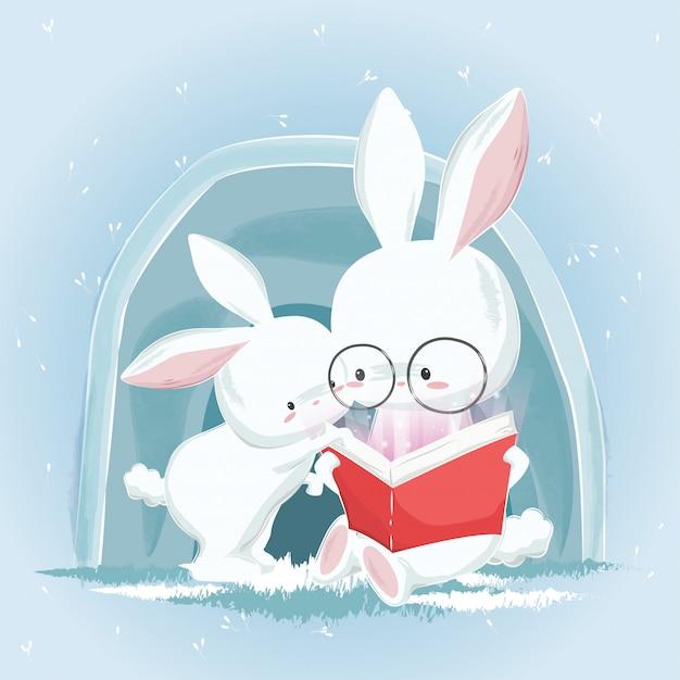 Simpatici coniglietti leggendo un libro Vettore Premium