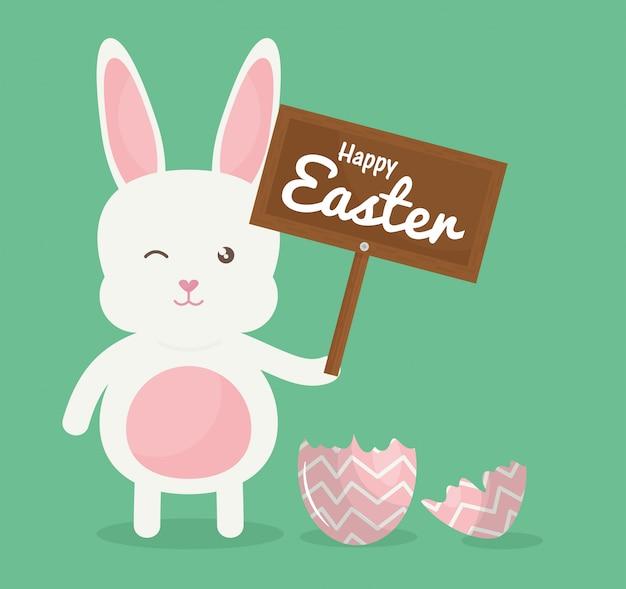 Simpatico coniglio con uovo di pasqua rotto dipinto Vettore Premium
