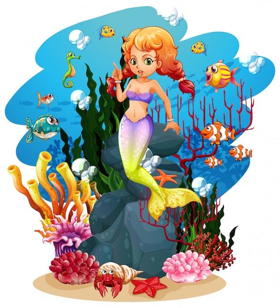 Sirena e molti pesci nell'oceano Vettore gratuito