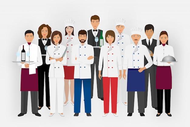Squadra del ristorante dell'hotel in uniforme. gruppo di personaggi della ristorazione in piedi insieme chef, cuoco, camerieri e barman. Vettore Premium
