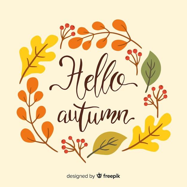 Stile disegnato a mano del fondo delle foglie di autunno Vettore gratuito