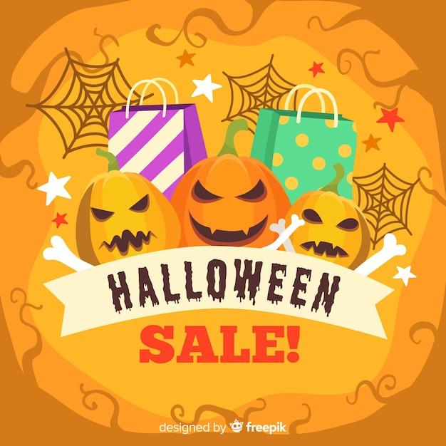 Stile disegnato a mano del fondo di vendite di halloween Vettore gratuito