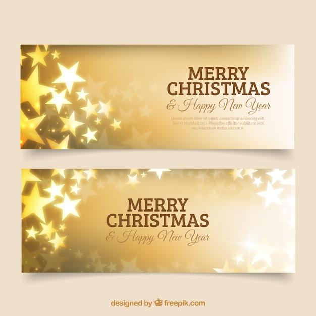 Striscioni d'oro per buon anno nuovo e di natale con le stelle Vettore gratuito