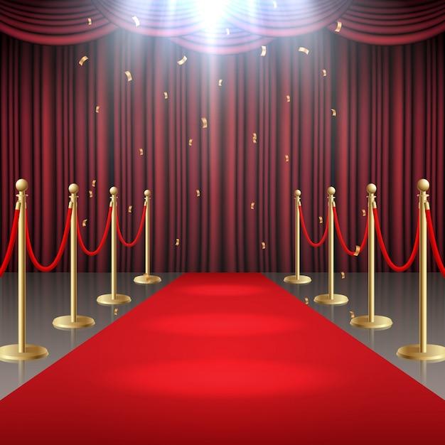 Tappeto rosso e tenda e corda della barriera nel bagliore dei riflettori Vettore Premium