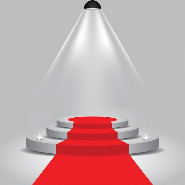 Tappeto rosso sul palco del podio con con riflettori Vettore Premium
