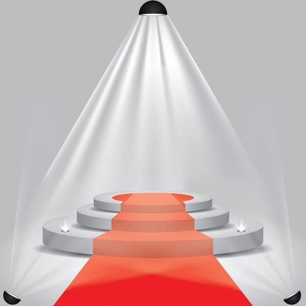 Tappeto rosso sul palco del podio con faretti Vettore Premium