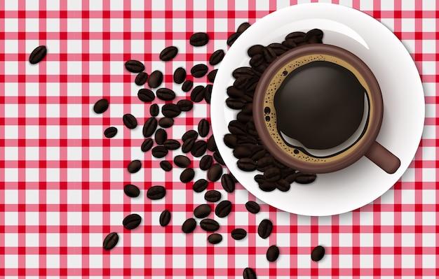 Tazza di caffè con chicchi di caffè su uno sfondo di tovaglia Vettore Premium