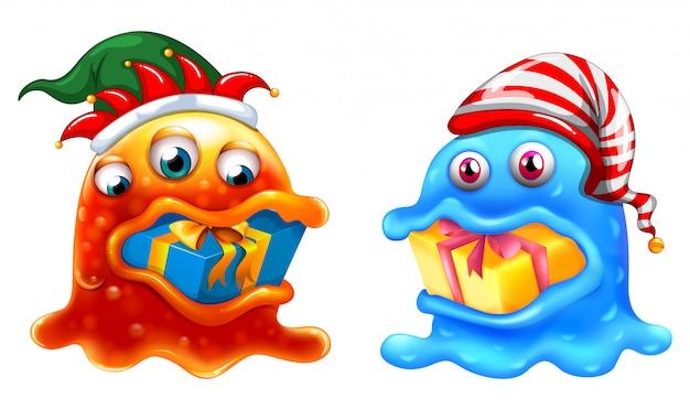 Tema natalizio con due mostri e regali Vettore gratuito