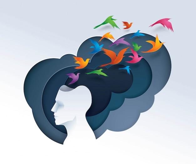 Testa umana con uccelli colorati che volano dalla testa Vettore Premium