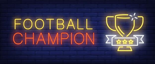Testo al neon campione di calcio con la tazza Vettore gratuito