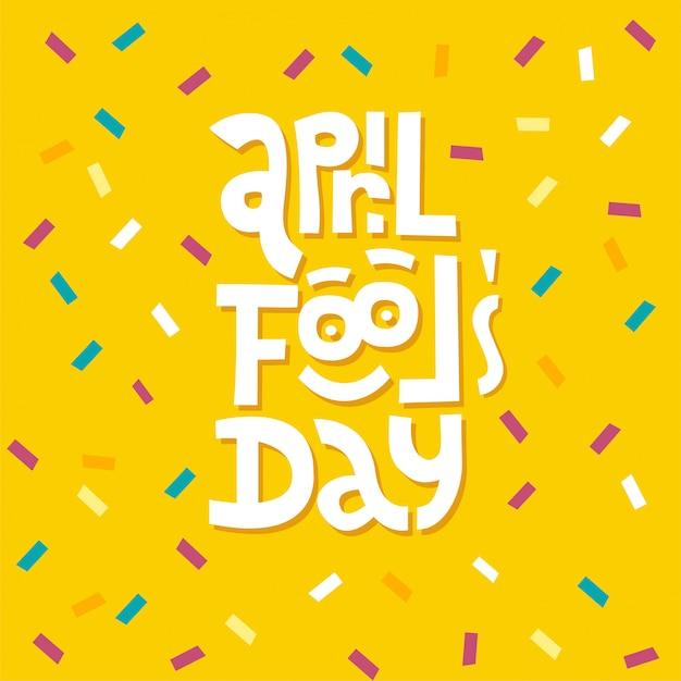 Tipografia dell'iscrizione di april fools day su fondo giallo con i coriandoli Vettore Premium