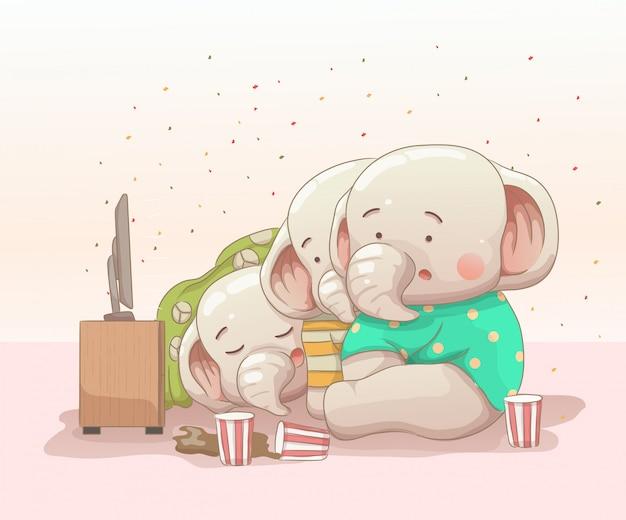 Tre elefantini che guardano film Vettore Premium