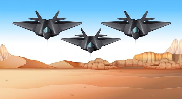 Tre jet da combattimento che sorvolano il deserto Vettore Premium