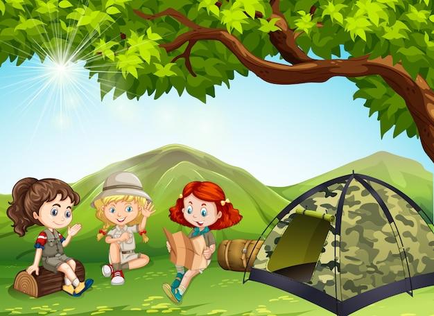 Tre ragazze si accampano nel campo Vettore gratuito