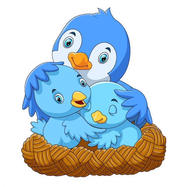 Uccelli con i suoi due bambini nel nido Vettore Premium