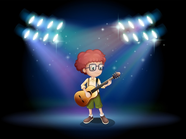 Un adolescente di talento nel mezzo del palco con una chitarra Vettore gratuito