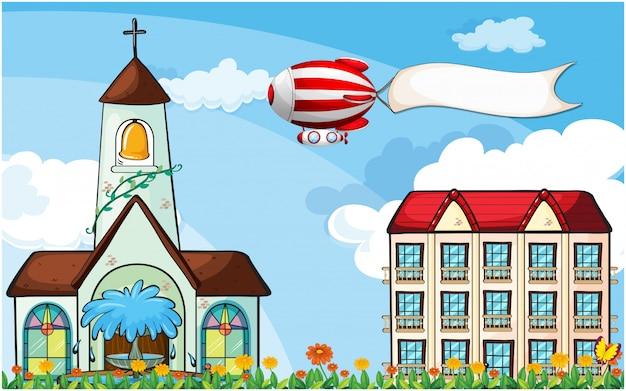 Un pallone con una bandiera vuota che vola vicino alla chiesa Vettore gratuito