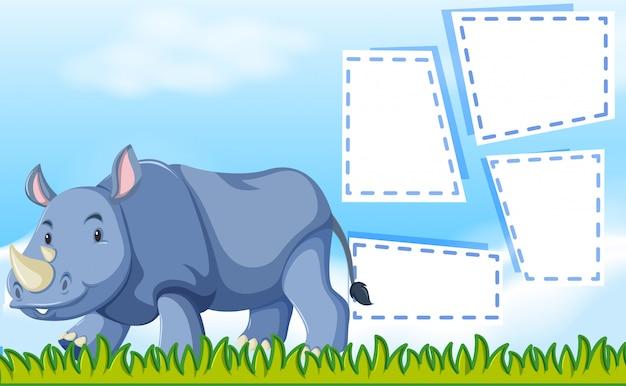 Un rinoceronte sul modello di nota Vettore gratuito