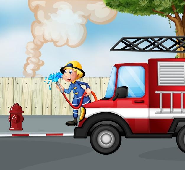 Un vigile del fuoco che salva un incendio vicino alla strada Vettore Premium