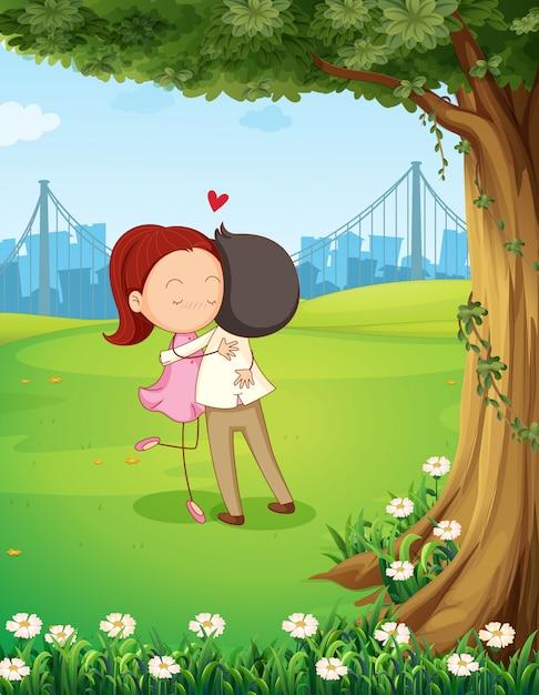 Una coppia che si abbraccia vicino all'albero Vettore Premium