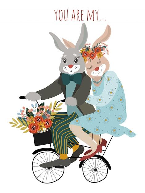 Una coppia di conigli innamorati in bicicletta con un mazzo di fiori Vettore Premium