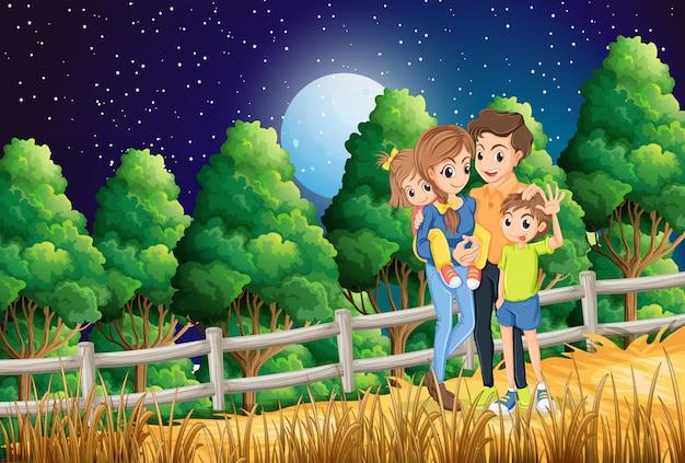 Una famiglia nella foresta Vettore gratuito