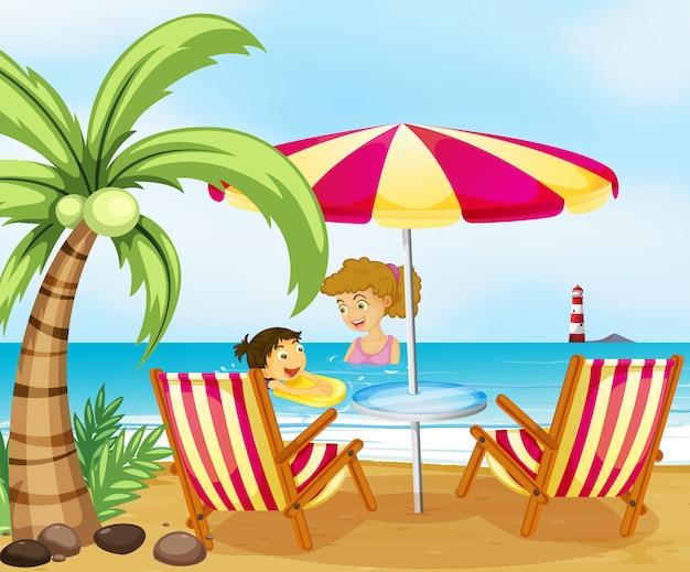 Una madre e il suo bambino in spiaggia Vettore gratuito