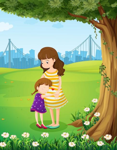 Una madre e sua figlia sotto l'albero Vettore gratuito