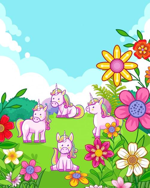Unicorni svegli felici con i fiori che giocano nel giardino Vettore Premium