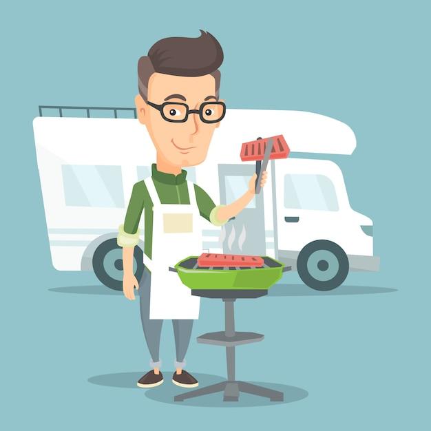 Uomo che ha barbecue davanti al camper. Vettore Premium