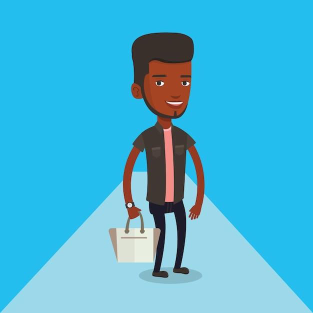 Uomo che posa sulla passerella durante la sfilata di moda. Vettore Premium