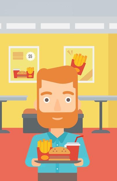 Uomo con fast food. Vettore Premium