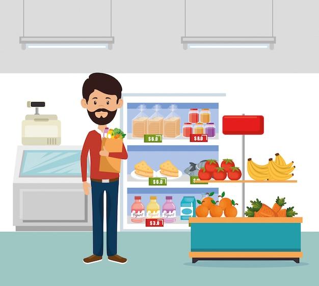 Uomo con generi alimentari supermercato in shopping bag Vettore gratuito