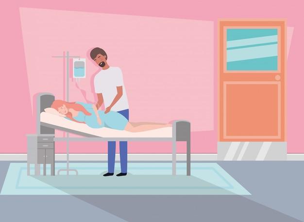 Uomo con la donna di gravidanza nella stanza d'ospedale Vettore gratuito