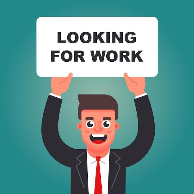 Uomo con un cartello in mano in cerca di lavoro Vettore Premium