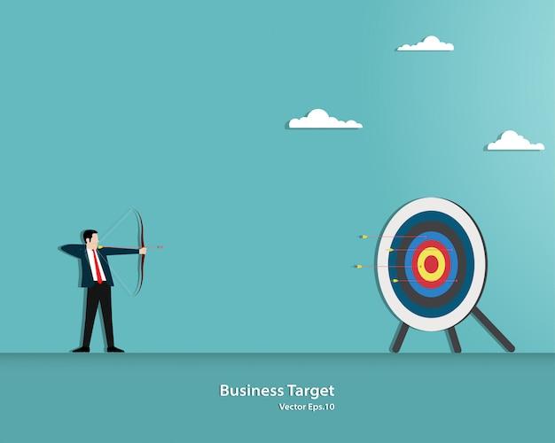 Uomo d'affari che mira obiettivo con l'arco e la freccia Vettore Premium