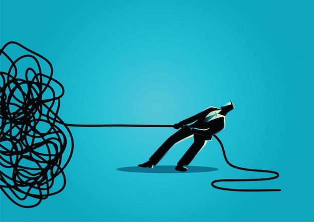Uomo d'affari che prova a disfare corda o cavo aggrovigliata Vettore Premium