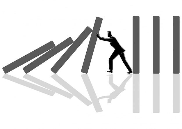 Uomo d'affari che prova a fermare l'effetto domino Vettore Premium